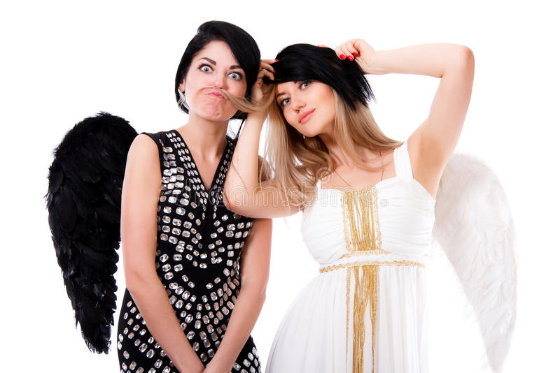 Black and white beautiful young angels playing tricks stock photo