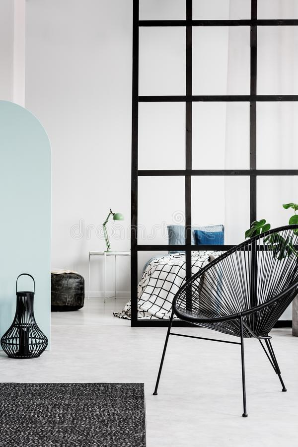 Black and white bedroom interior with chic armchair, lantern and king size bed. Black and white bedroom interior with armchair, lantern and king size bed royalty free stock images