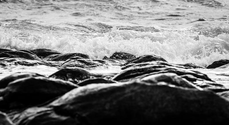 Black and white and blue sea stock image