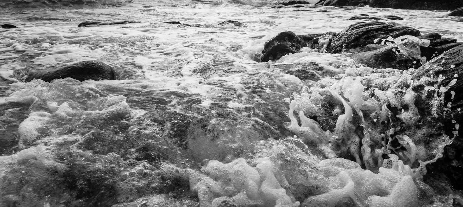 Black and white and blue sea stock photos