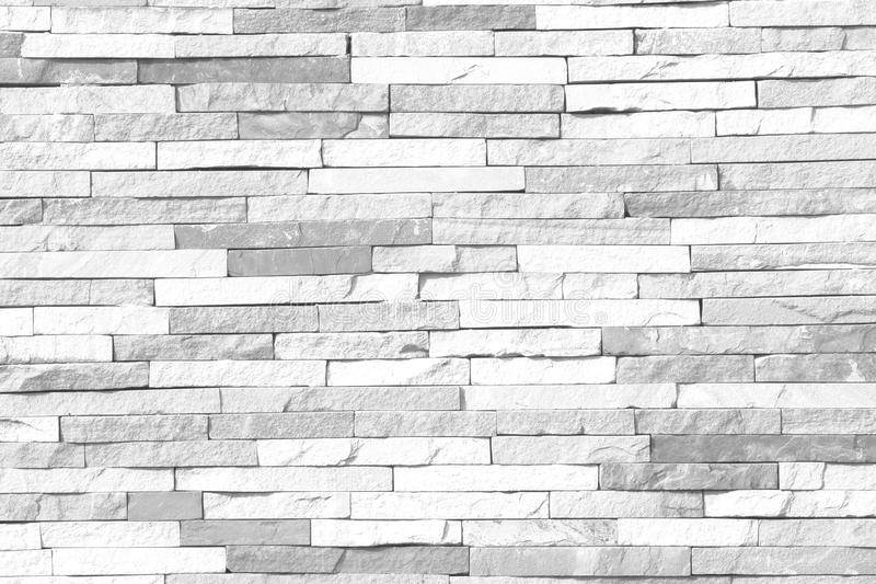 Black and White brick wall pattern of modern style design decorative uneven royalty free stock photo