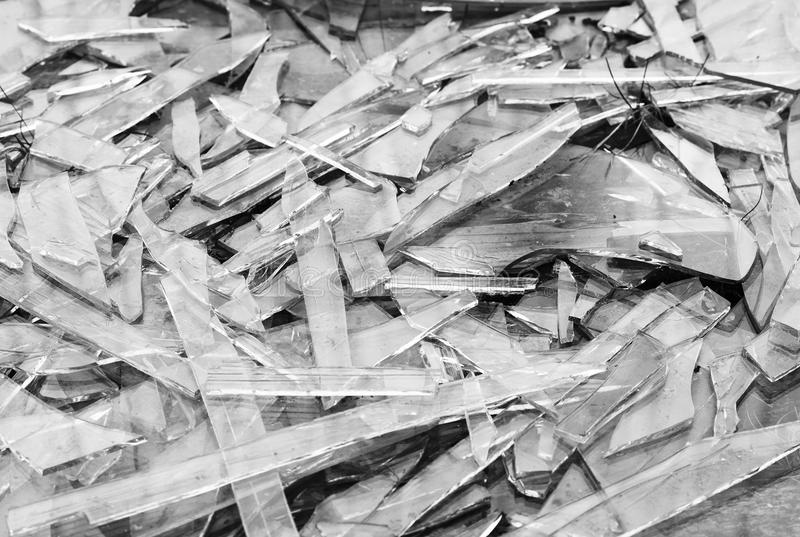 Black and white broken glass fragments texture background royalty free stock image