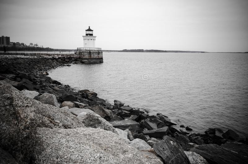 Black and white Bug Lighthouse on Cape Elizabeth Maine. Distant wide angle view of Bug Lighthouse on Cape Elizabeth Maine stock image