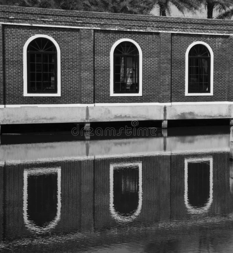 Black white buildings and reflection in the water royalty free stock photography