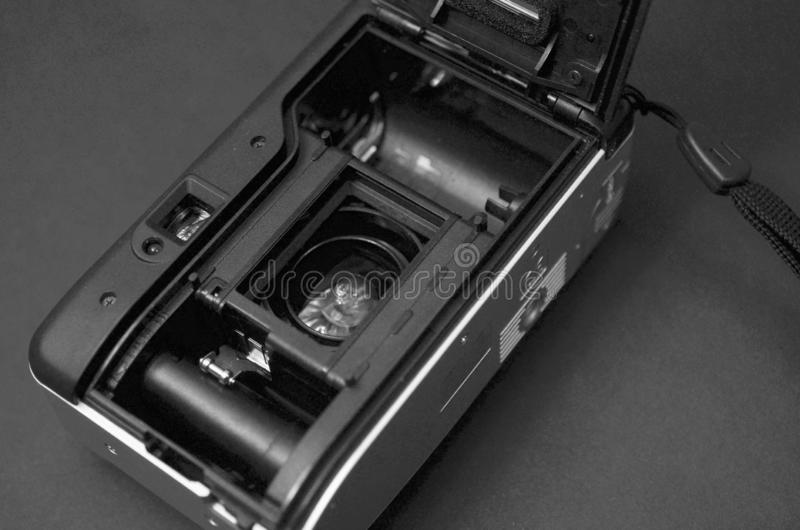 Black and white camera film 35mm on table background stock image