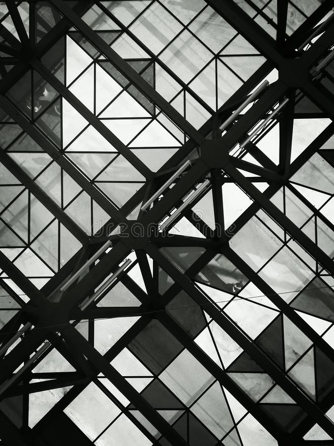 Black and white photo of glass ceiling with geometric shapes royalty free stock images