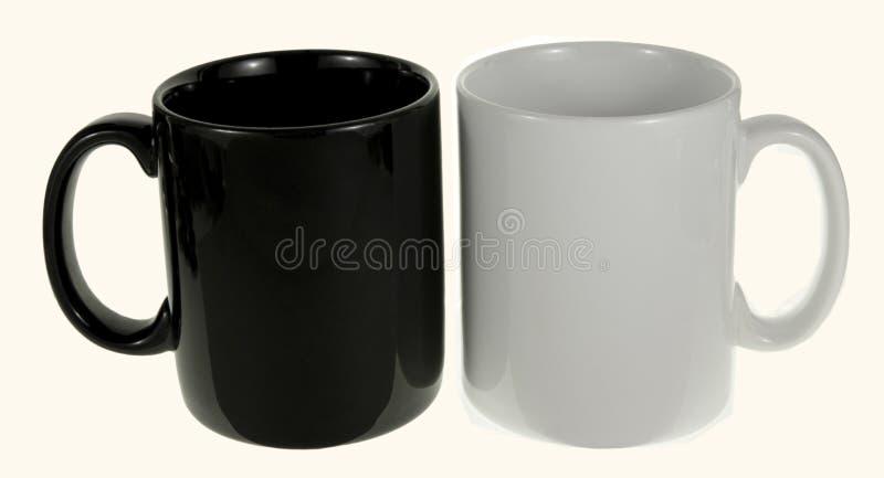 Black and white ceramic mug. On a white background stock images
