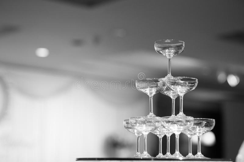 Black and white Champagne glass pyramid.pyramid of glasses of wine,. Champagne, tower of champagne`s glass in wedding reception party stock images