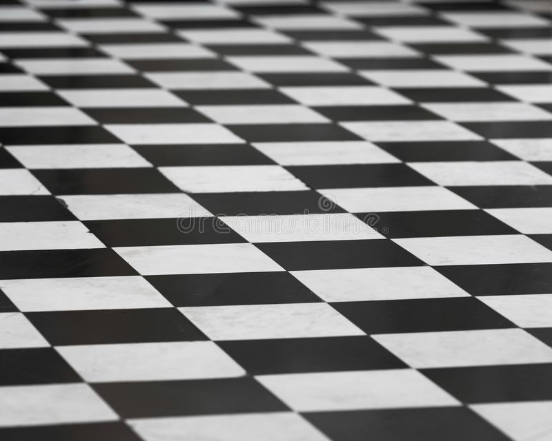 Checkered black and white tile floor royalty free stock photography