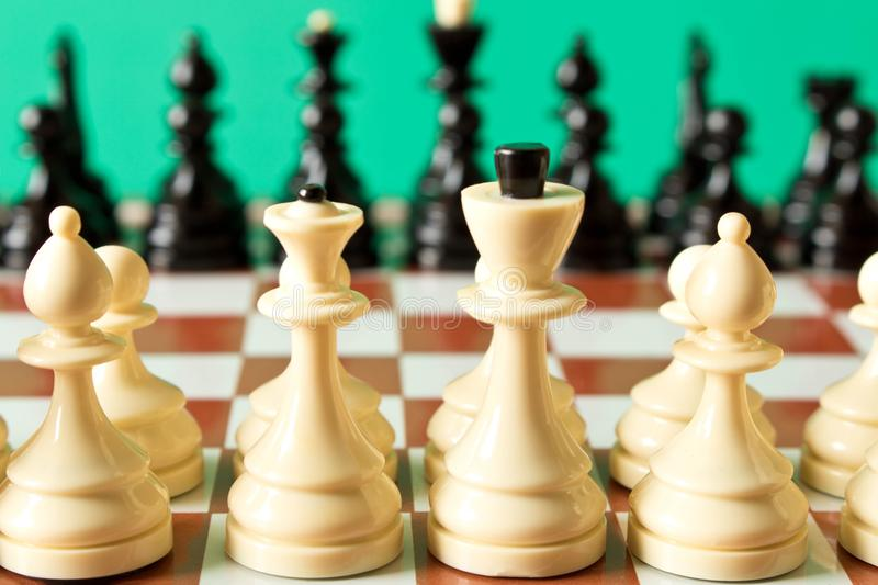 Black and white chess on the chessboard. Selective focus stock images