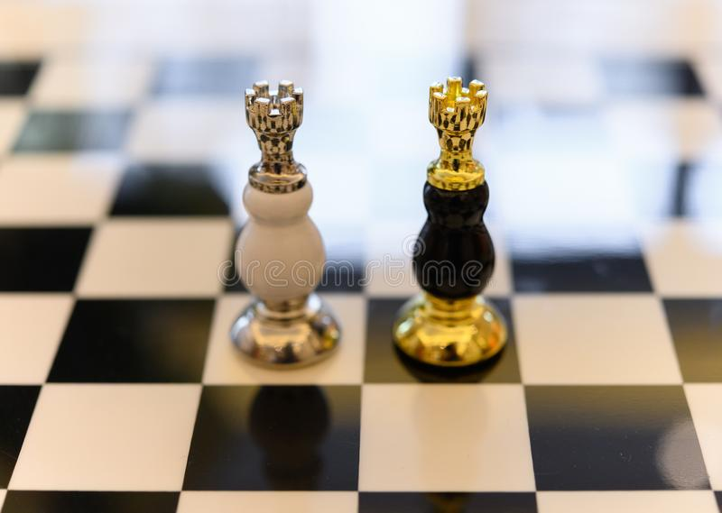 Black & white Chess Kings stand on the board. Black and white Chess Kings stand on the board royalty free stock images