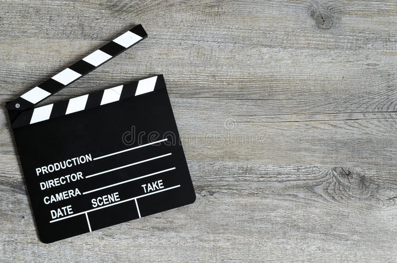 Black and white ciack on a wooden background. Director's cut. Black and white ciack on a wooden background. Beginning, start, presentation stock photos