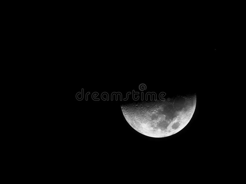 Black and white clear half moon HDR image stock photography
