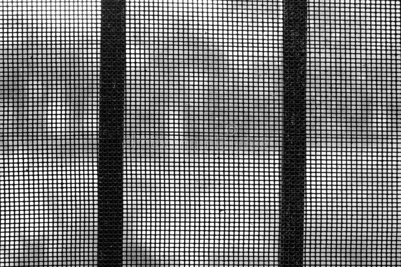 Black and white close up a dusty grill and steel net. royalty free stock photo
