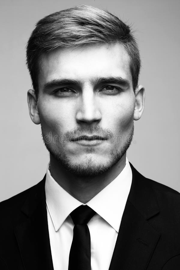 Black and white close-up portrait of a successful handsome busin stock images
