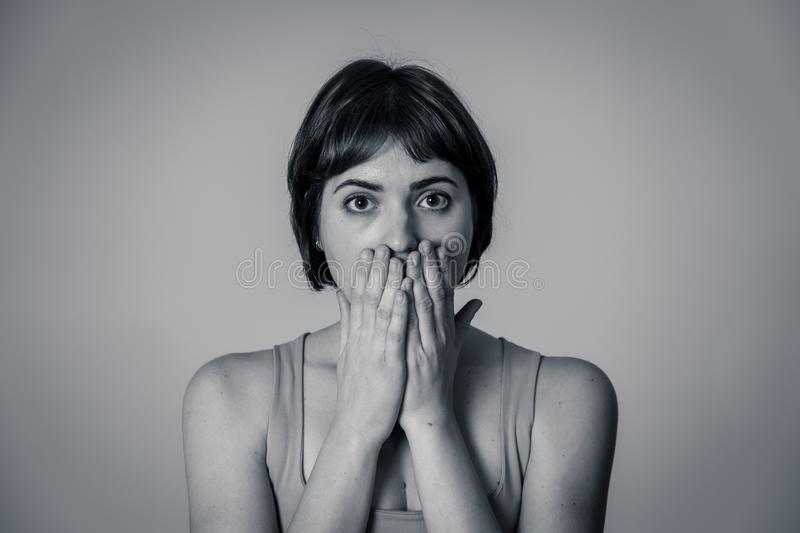 Portrait of a young attractive woman looking scared and shocked.Human expressions and emotions royalty free stock photography