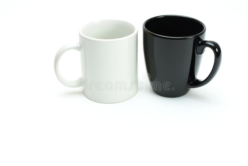 1 black 1 white coffee mugs side by side, high key, room for tex royalty free stock photos