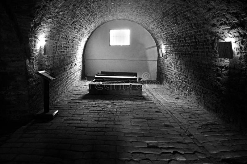Coffins and tunnels at the Ceremonial Hall and Central Morgue of the former Jewish Ghetto at Terezin Czech Republic. Black and white Coffins and tunnels at the royalty free stock images