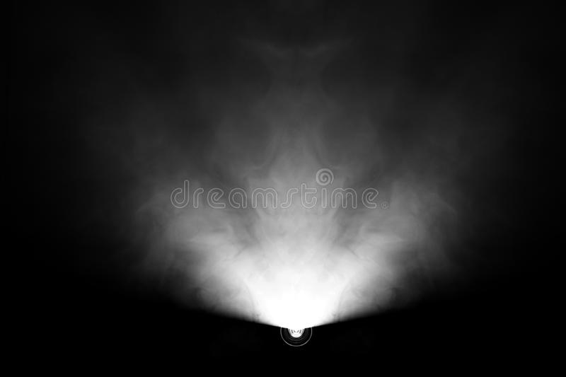 Black and white color . projector beautiful spotlight . wide lens equipment for show presentation at night . smoke abstract. Background . digital monitor for stock images