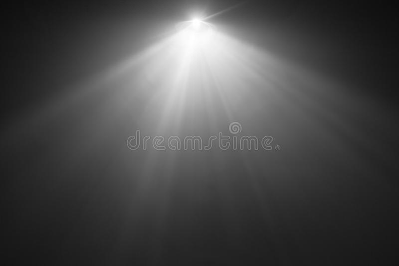 Black and white color wide lens projector . smoke texture spotlight . abstract background . Beautiful black and white color wide lens projector with light beam royalty free stock images
