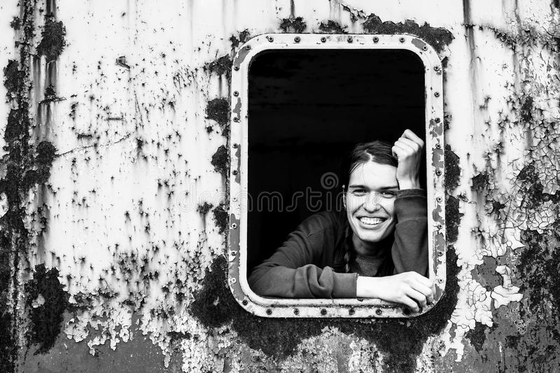 Black and white contrast portrait of a young happy woman. royalty free stock photography