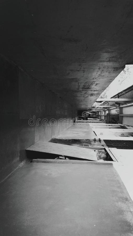 Black and white of a corridor in a building royalty free stock image