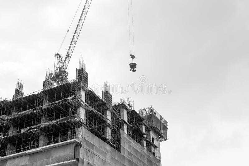 Black and white of Crane on the building under construction stock photo