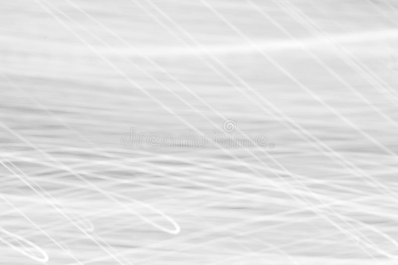 Black and white curve lines of light motion for background, monochrome style. Black and white curve lines of light motion, monochrome style, use for background stock image