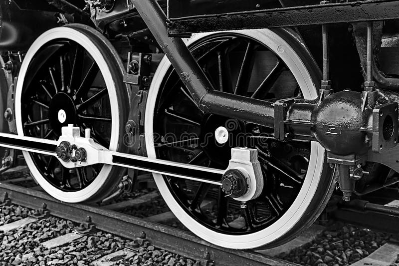 Black and white detail and close up of huge wheels at one old steam locomotive royalty free stock photography