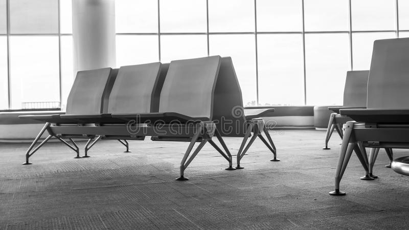 Black and white empty airport terminal waiting area with chairs. Lounge in the airport with seats royalty free stock image