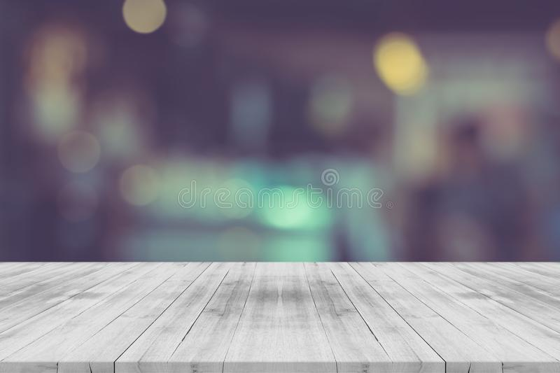 Black and white empty wood table top on blurred background stock image