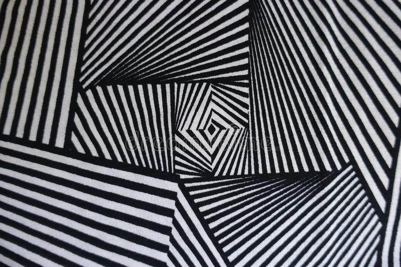 Black and white fabric with geometric pattern. From above royalty free stock photo