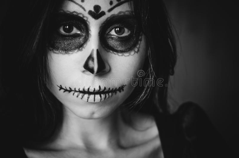 Female portrait in Catrina Calavera style close up horizontal. Black and white female portrait in Catrina Calavera style of Mexican Day of The Dead close up stock image