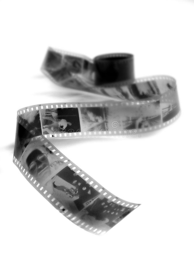 Black and white film negatives. Long roll of black and white film with photographic negatives royalty free stock photos