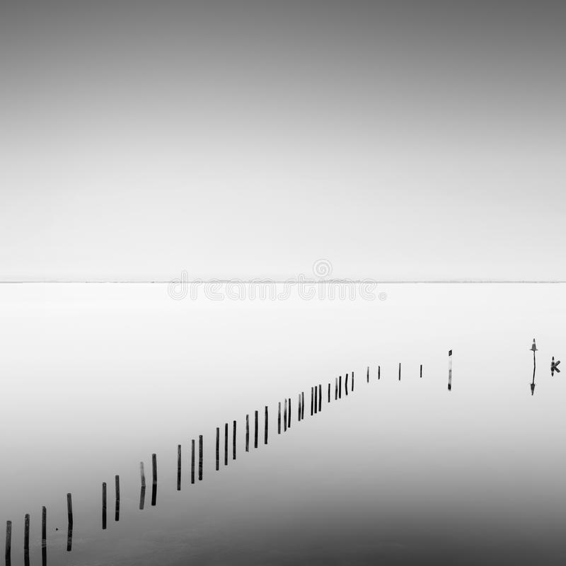 View of Missolonghi lagoon with wooden pillars royalty free stock image