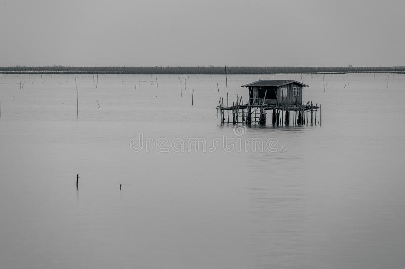 Black and white of fisherman house on ocean royalty free stock photos