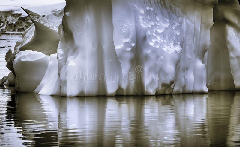 Black and White Floating Iceberg Reflection Paradise Bay Skintorp Cove Antarctica stock photo