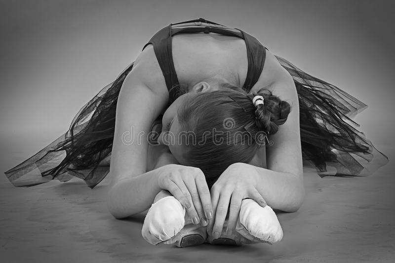 Black and white foto of stretching ballerina stock image