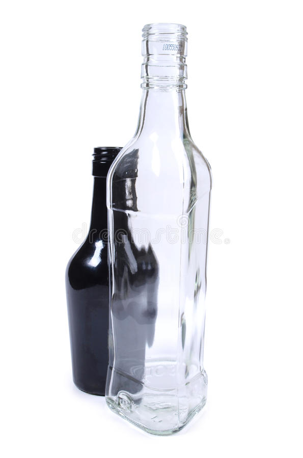Black and white glass bottle. Color photo of glass bottle with a white background royalty free stock photo