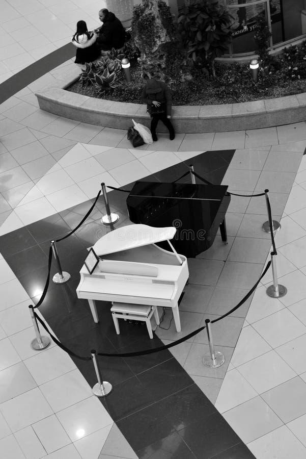 Black and white grand piano, shopping center Capital, Minsk, Belarus. Black and white grand piano, shopping center capital Stolotsa, Minsk, Belarus stock photo