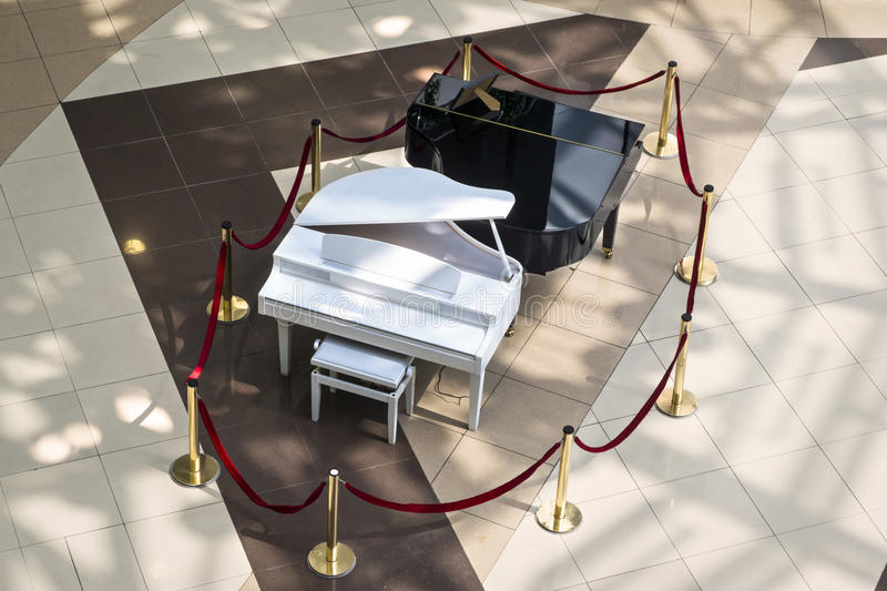 Black and white grand pianos. Two grand pianos, black and white stock photo
