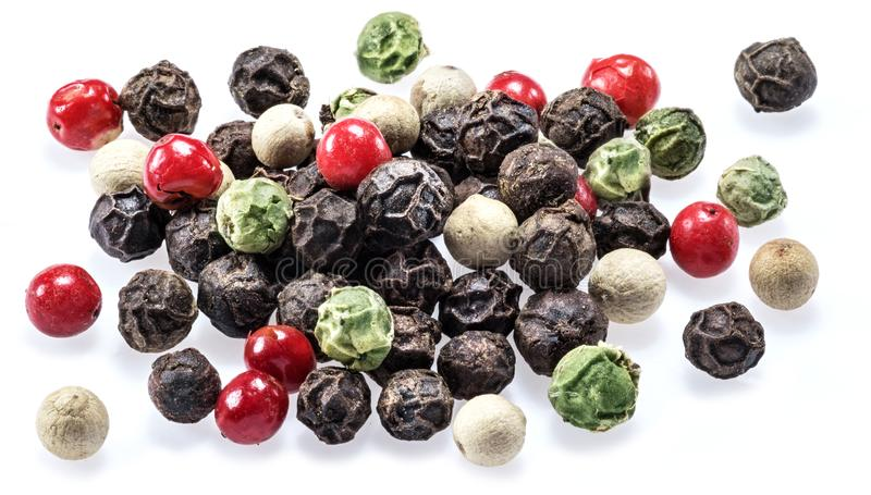 Black, white, green and red peppercorns isolated on white background.  royalty free stock photo