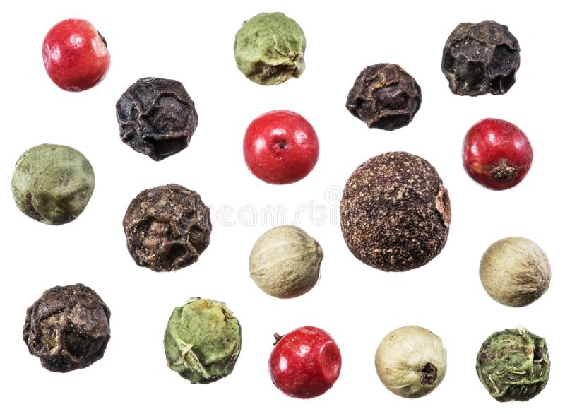 Black, white, green and red peppercorns isolated on white background.  royalty free stock image
