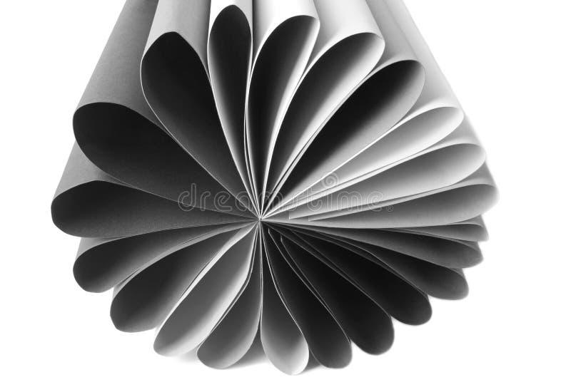 Grey paper folded isolated on white royalty free stock photo