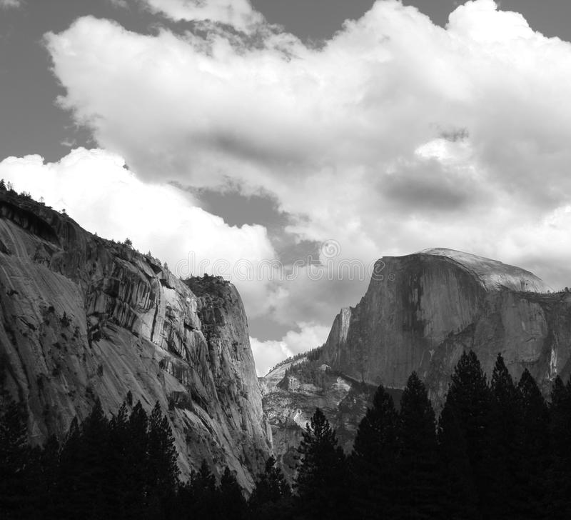 Black and white half dome. Black and white landscape shot of half dome in yosemite. High contrast and cloudy day stock photo