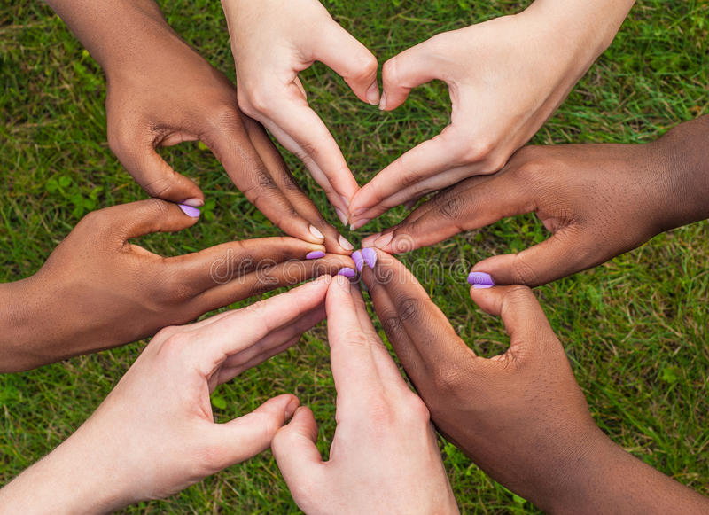 Black and white hands in heart shape, interracial friendship concept. Black and white hands in heart shape, interracial friendship royalty free stock image