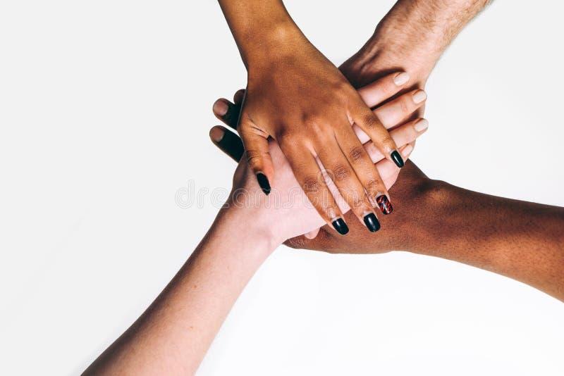 Black and white hands, international friendship stock photos