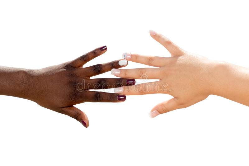 Black and white hands together. royalty free stock images