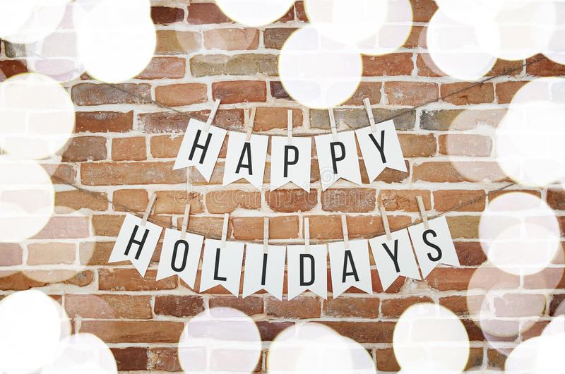 Black and white HAPPY HOLIDAYS paper garland wall decoration royalty free stock photography