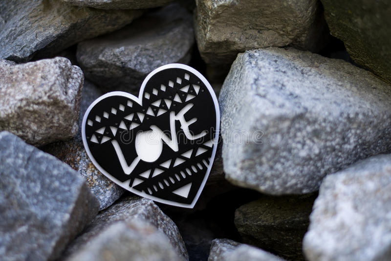 Black and white heart with love text inside royalty free stock image